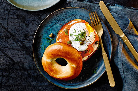 Toasted bagel halves topped with crème fraîche, smoked salmon, dill and a poached egg, the perfect breakfast or brunch