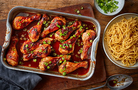 Chicken drumsticks are a great wallet-friendly way to feed the family - make the most of them in this sticky Chinese chicken drumstick traybake, with a glossy honey, ginger and soy dressing. Serve with simple noodles and scatter with spring onions.