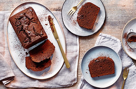 This simple chocolate loaf cake recipe is the perfect easy baking recipe for new bakers. Rich and fluffy chocolate cake is studded with melting chunks of dark chocolate and all made in just one bowl for cake ready in an hour!