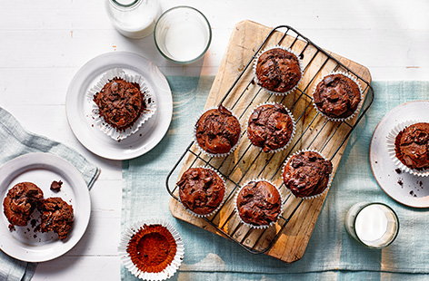Bake a batch of this fluffy chocolate muffins recipe, studded with melting chunks of dark chocolate, for a crowd-pleasing bake - pack up for picnics or save for an afternoon treat.