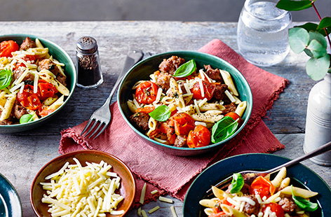 This crispy sausage and tomato pasta is a quick and easy dish that takes less than 20 minutes to make. Combining flavoursome pork sausages with a fresh tomato sauce, it's sure to be a family favourite.