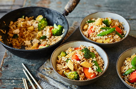 Turn a box of eggs and a packet of rice into a quick and easy dinner with this egg-fried rice recipe. Load up crispy rice with plenty of veg, ginger and garlic, then fry with beaten eggs for a wallet-friendly midweek meal.