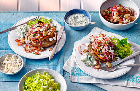 Swap a plain jacket potato for this healthy Greek-inspired stuffed sweet potato recipe instead. Fill your potato with a colourful butter bean, feta, tomato and red onion salad and finish with a dollop of homemade tzatziki for an easy healthy dinner idea.
