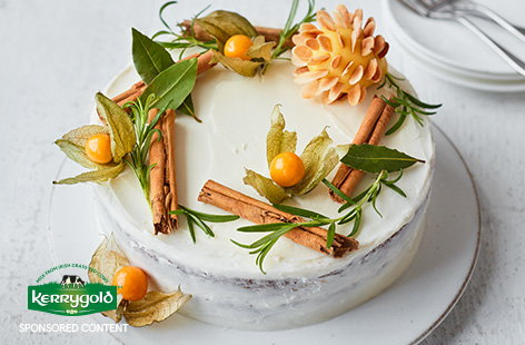 Transform classic Christmas cake into a simple yet stunning centrepiece with beautiful rustic decorations, sweet amaretto-spiced icing, and an almond-encrusted marzipan pinecone