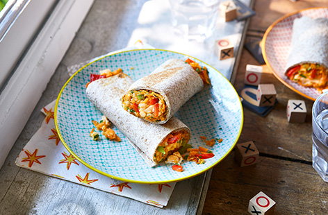 Make a batch of this breakfast burritos and store in the freezer for a make ahead breakfast that makes mornings easy. Wholemeal tortillas are loaded with scrambled egg, peppers, cheese and sweet potato for a healthy kids breakfast idea.
