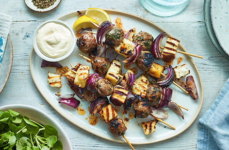The only thing better than fried halloumi is barbecued halloumi as these kebabs demonstrate: homemade lamb meatballs with garlic, mint, lemon zest and honey, skewered with the halloumi and chunks of red onion. A Greek holiday on a plate.