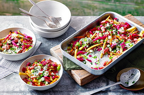Turn fries into dinner with this loaded sweet potato and parsnip fries recipe. Topped with crispy bacon, a creamy blue cheese sauce and tangy pickled cabbage, this is a meal everyone can enjoy.