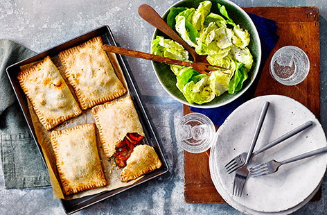 Give a classic British pasty a Mediterranean spin with this veggie pasties recipe. Buttery shortcrust pastry is filled with courgettes, peppers and red onion in a simple herby tomato sauce for an easy savoury bake.