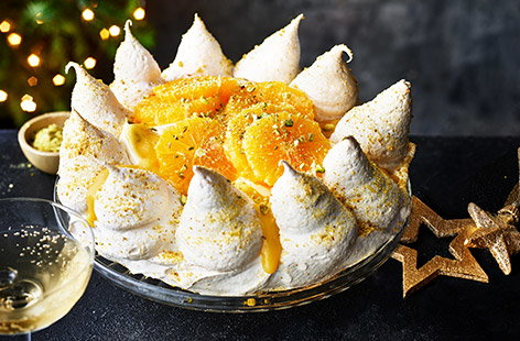 With zesty segments of orange and crushed pistachios this easy Christmas Pavlova is the perfect pud for the big day