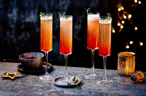 For a fruity festive cocktail idea, try this plum and prosecco fizz recipe. Simmer plums and vanilla into a sweet syrup, then top up with prosecco for a pretty Christmas drink.