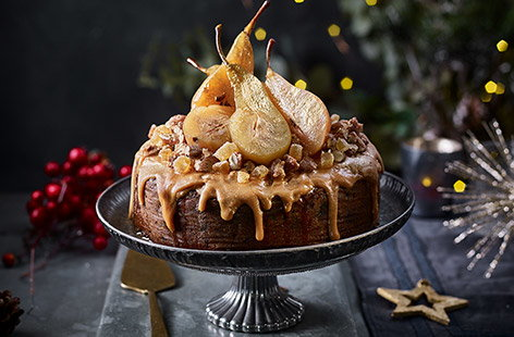 Poached pears add a delicate sweetness to this simple homemade Christmas cake