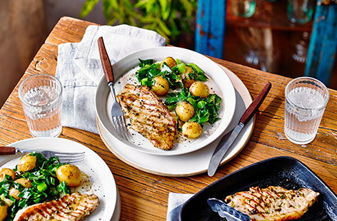 Pack pork with flavour with this herby marinated pork loin recipe, served with potatoes and fresh greens for a hearty dinner idea ready in 30 minutes. Pork steaks are marinated in lemon, garlic and fresh coriander then griddled for a simple summer meal.