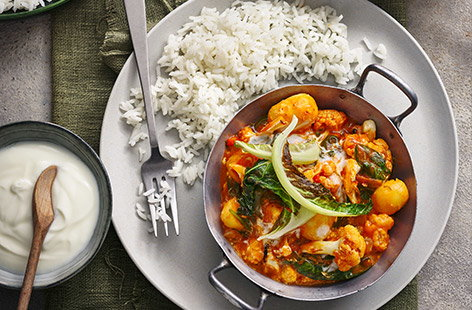 This vegetarian spin on a classic tikka masala curry recipe uses nutty cauliflower and tinned new potatoes