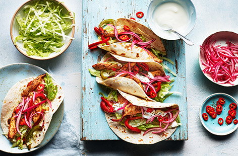 Spice up your midweek meals with these zingy chicken tacos that are ready in just over half an hour