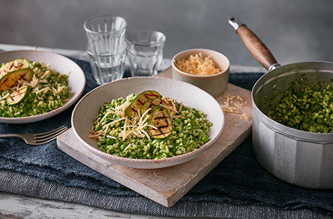 xxPack three different veg into your dinner with this creamy green veg risotto. With a quick homemade spinach sauce, colourful peas and griddled courgettes, this is the perfect spring twist on an Italian classic.