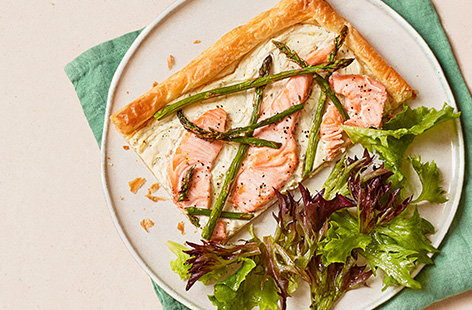 Garlic and herb soft cheese lines the base of this quick and simple salmon and asparagus tart