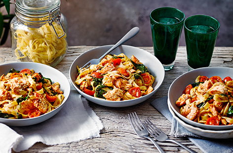 For a quick and easy midweek pasta recipe, try this sesame-crusted salmon harissa tagliatelle recipe. Salmon is baked with a sesame crust for extra crunch, then flaked into tagliatelle with a spicy harissa sauce and juicy cherry tomatoes.