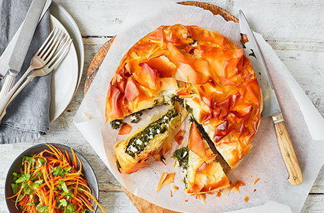 Bake this spinach and feta filo pie recipe for a hearty family meal - packed with veg, crumbly cheese and wrapped in crispy filo pastry. Serve with a fresh, herby carrot salad for dinner or pack up slices for a picnic lunch.