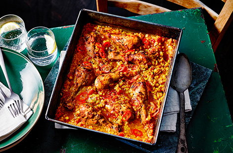 Let the oven do the work with this easy chicken traybake recipe. Combine red lentils, tomatoes and spices and roast with chicken drumsticks for a simple one-pan meal.