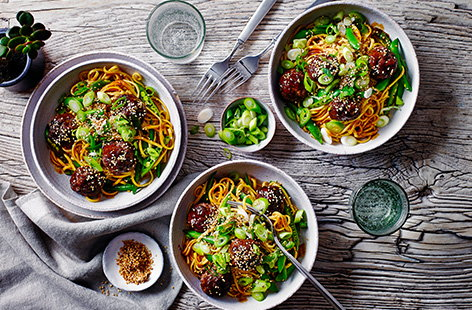 Meatballs are a great midweek staple, so try this sticky hoisin meatball traybake recipe for something a little bit different. Meatballs are baked in a hoisin glaze for an easy method, then tossed with noodles and sugar snaps for a 30-minute meal.