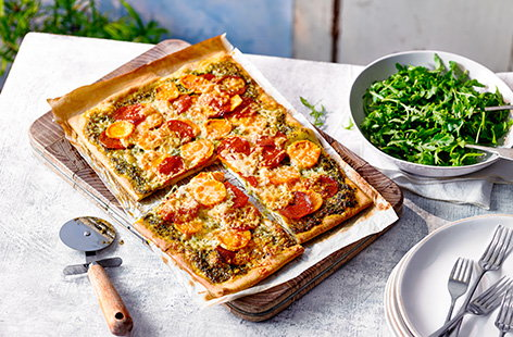 Serve up a feast with this family-style sweet potato, pesto and pepperoni pizza recipe. This unusual combination really works, using ready made pizza dough for a quick pizza fix - slice into generous squares and serve with a peppery rocket salad.