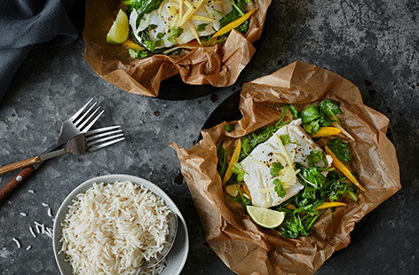 These Thai fish parcels are the perfect stress-free dinner. Simply wrap cod, spinach and peppers in baking paper with a drizzle of fragrant ginger and lime dressing and bake in the oven. Unwrap and serve with rice and fresh coriander.