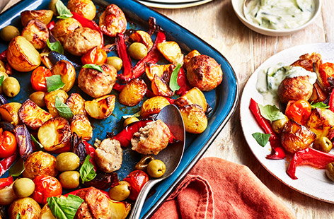 Feed your family right with this simple, delicious and nutritious turkey meatball traybake recipe. Serve the meatballs and vegetables with torn basil leaves before topping liberally with homemade cucumber yogurt