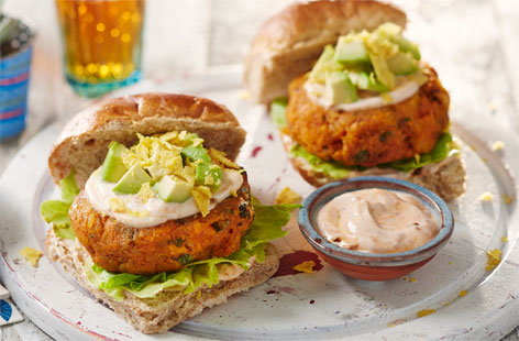Add a Mexican touch to your veggie burgers, by combining sweet potato with rice, coriander, almonds and spices. The burgers are gluten-free, so can be served with gluten-free rolls and gluten-free tortilla chips. If gluten isn't an issue, use 2tsp breadcrumbs instead of the ground almonds.