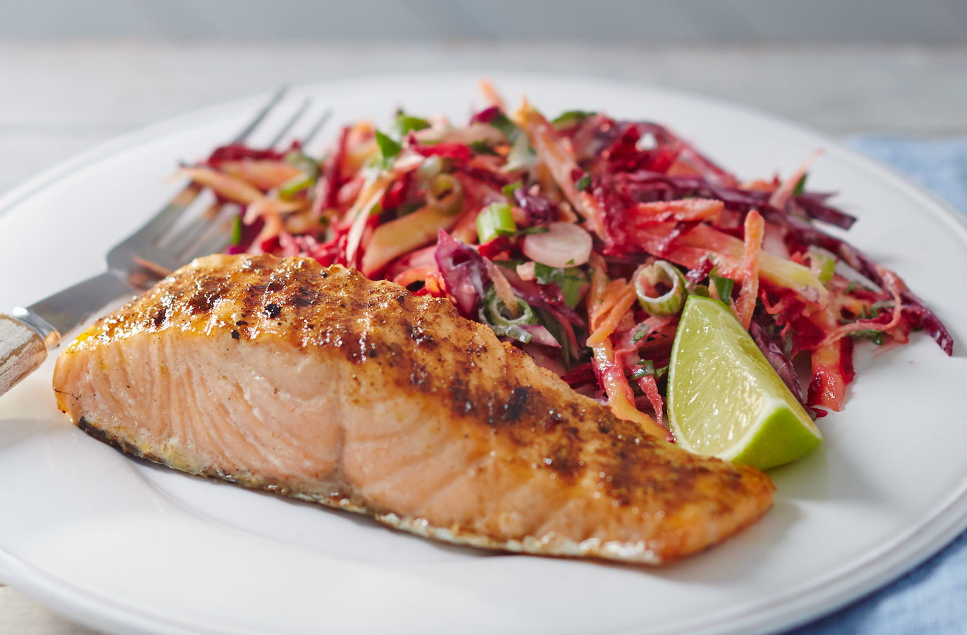 Jerk salmon with tangy mango slaw recipe