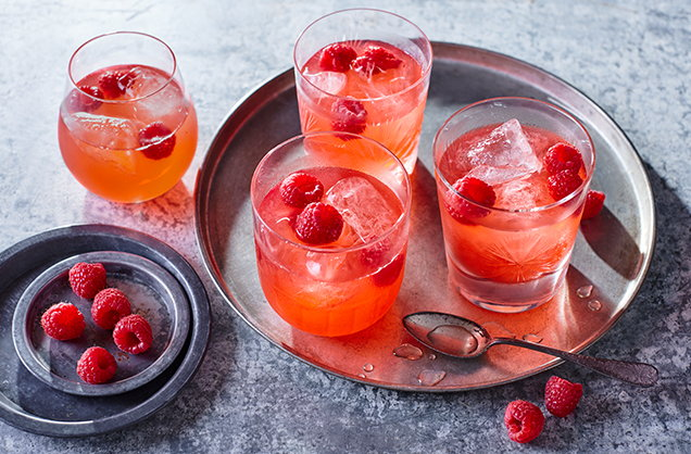 Raspberry whisky sour cocktail
