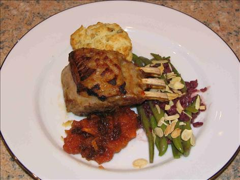 ROAST RACK OF LAMB WITH TOMATO AND RAISIN RELISH, SOUFFLÉD POTATO PATTIES AND A WARM FRENCH BEAN VINAIGRETTE