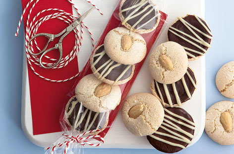 These festive home-bake macaroons make for a delicious edible gift or even just a warming winter tuck-in. Packed with rich almond flavour and a mixed blend of chocolate icing, friends and family are sure to love them.