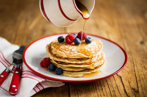 Classic American pancakes are stacked tall, fluffy and best served with a drizzle of maple syrup. This easy recipe ticks all those boxes - perfect for Pancake Day or a weekend brunch treat.