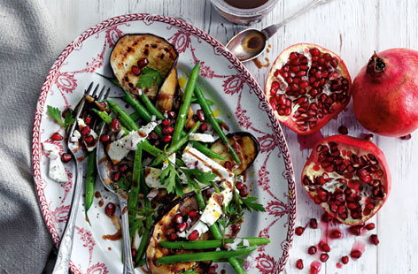 This beautiful summer vegetable salad is made with crunchy green beans and delicious chargrilled aubergines. Tangy feta and juicy pomegranate seeds should be sprinkled over the top just before this side dish or starter for two is served.