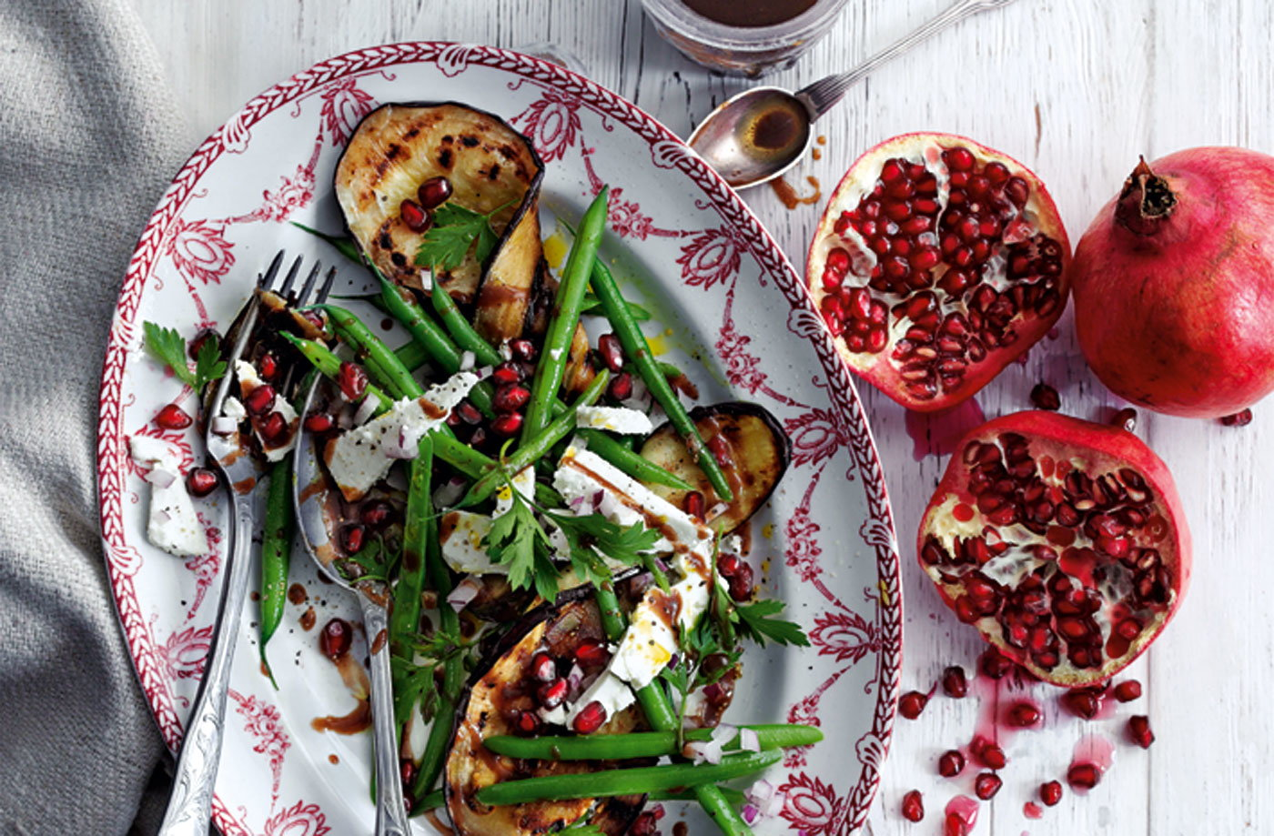 Grilled aubergines with green beans, feta and pomegranate seeds