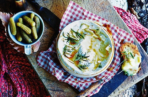 Bonfire Night snacks don't come much more tempting than this - a whole Camembert baked in the oven until gorgeously gooey and stuffed with garlic and herbs for extra flavour. Rustle up this easy recipe and serve alongside some crunchy bread