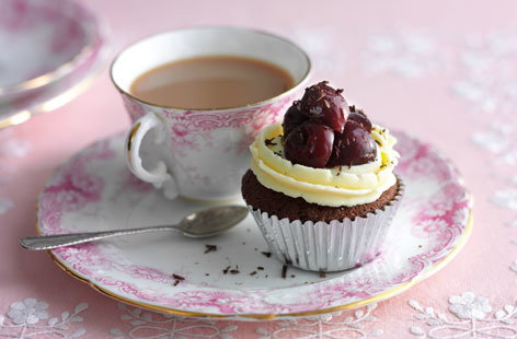 These delicious cupcakes are a clever spin on a retro classic, black forest gateaux. Combining sweet and juicy cherries with a decadent sponge and an optional glug of Kirsch, they are sure to go down a treat at your afternoon tea.