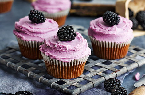 Use blackberries for a seasonal twist on the classic red velvet cake. These indulgent blackberry and chocolate cupcakes are smothered in a glossy cream cheese frosting and topped with dark, plump, shiny jewels