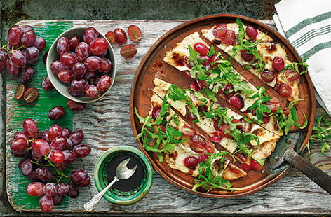 Sweet, juicy grapes are a perfect match for creamy brie and peppery rocket on these rustic flatbreads. A sophisticated snack to share with friends.