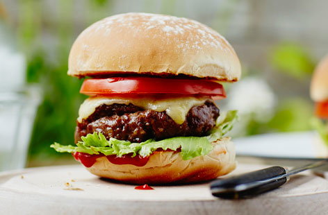 The classic burger is an all time BBQ favourite! This super easy recipe gives you delicious burger patties, packed with onions, herbs and seasoning for extra flavour and juiciness, that are perfect for topping with cheese, lettuce and tomato