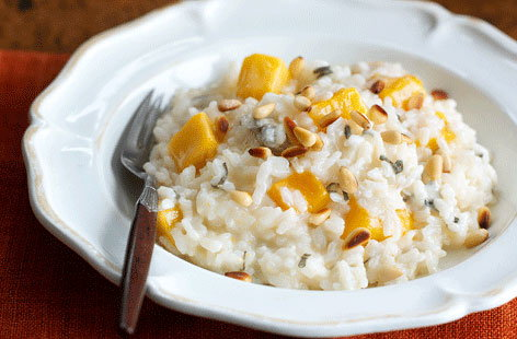 Risotto is a great way of making delicious ingredients go further and this recipe is no exception. Peeled and cubed butternut squash is softened with garlic and then gently cooked with rice in wine and stock. For extra oompf, Gorgonzola and toasted pinenuts are added at the end.