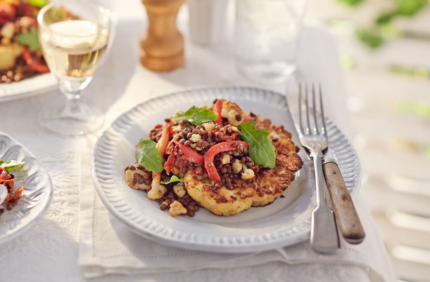 Roast cauliflower steaks with puy lentil, goat's cheese and pepper salad recipe