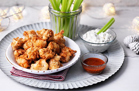 The perfect party food – buttermilk-marinated chicken lightly fried and served with a creamy blue cheese dip, fiery cayenne pepper sauce and crisp celery sticks. This easy recipe shows just how simple it is to make popcorn chicken at home
