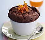 Chocolate soufflés with orange and cardamom sauce