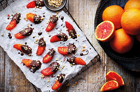 For an easy sweet snack that's ready in no time, try these chocolate-dipped orange segments with juicy Jaffa red oranges