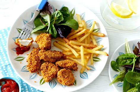 A lighter twist on a classic kids' favourite, these baked chicken nuggets are made with cornflakes for extra crunch
