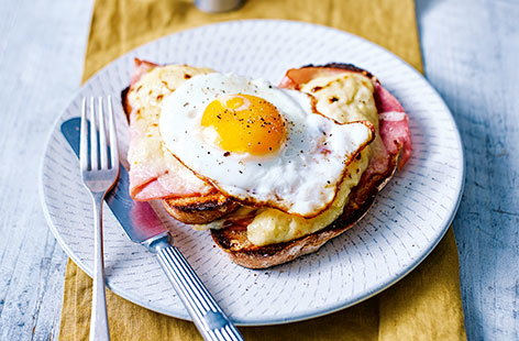 For a classic French breakfast recipe, give this delicious croque madame a try. Slices of crisp, toasted sourdough, layered with fresh ham, Gruyère cheese and creamy béchamel sauce, all topped off with a perfectly cooked egg