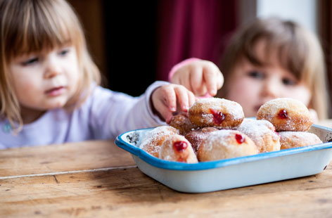These light and delicious jam-filled doughnuts are so fun to make, with lots of opportunities for children to practice their kneading, rolling and piping skills.