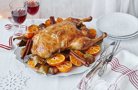 Slow-cooked until tender and coated in a mouthwateringly sticky glaze, this duck is a stunning centrepiece to serve up on Christmas day. Serve with roasted shallots, juicy clementines and cinnamon sticks for a wonderfully festive main.