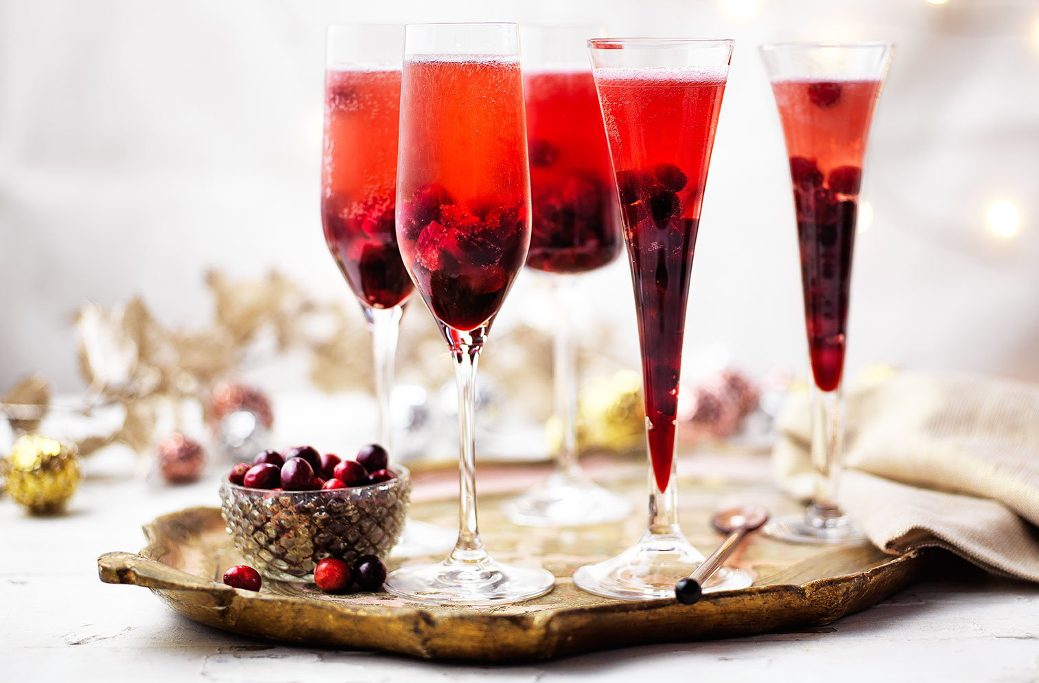 Festive fruit gives this Kir Royale an extra special twist. With a syrup made from fresh cranberries, Crème de Cassis and sugar this Champagne cocktail is the perfect Christmas party idea